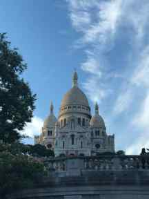 Sacre Couer, at the hill of Montmartre in Paris which affords panoramic city views and peddlers selling Heineken.